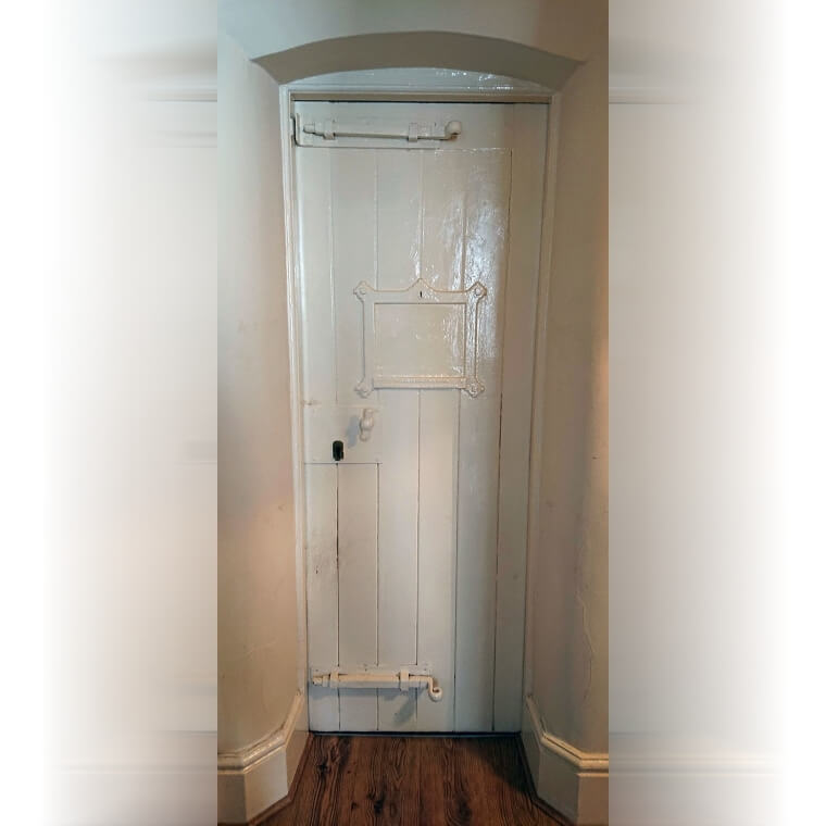 Original Cell Doors In An Old Police Station Turned Apartment Building